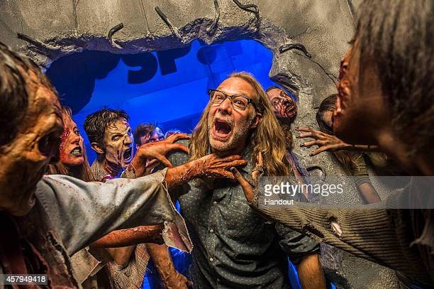 In this handout photo provided by Universal Orlando Greg Nicotero CoExecutive Producer and Director of Special Effects MakeUp Artist for AMC's 'The...