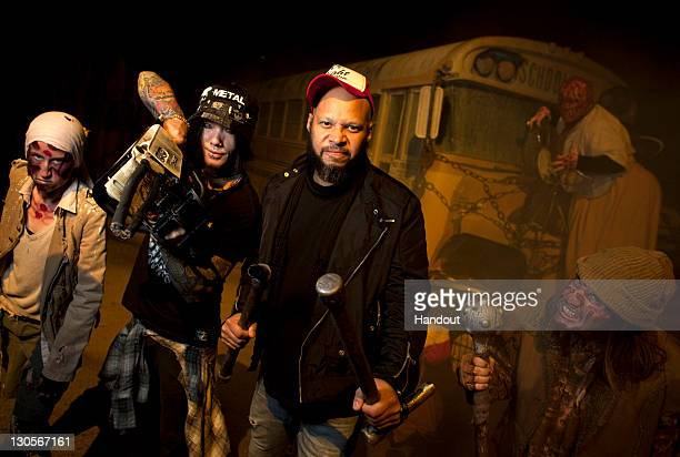 In this handout photo provided by Universal Orlando members of legendary hard rock band Guns N' Roses DJ Ashba and Frank Ferrer showed an appetite...