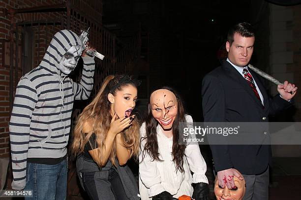 In this handout photo provided by Universal Orlando pop music sensation Ariana Grande bravely roamed the terrifying streets of Halloween Horror...