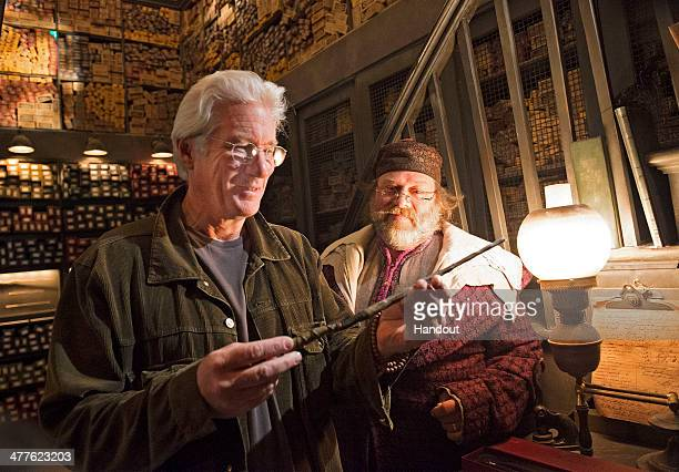 In this handout photo provided by Universal Orlando Resort Golden Globe awardwinning actor Richard Gere visited Ollivanders wand shop at The...