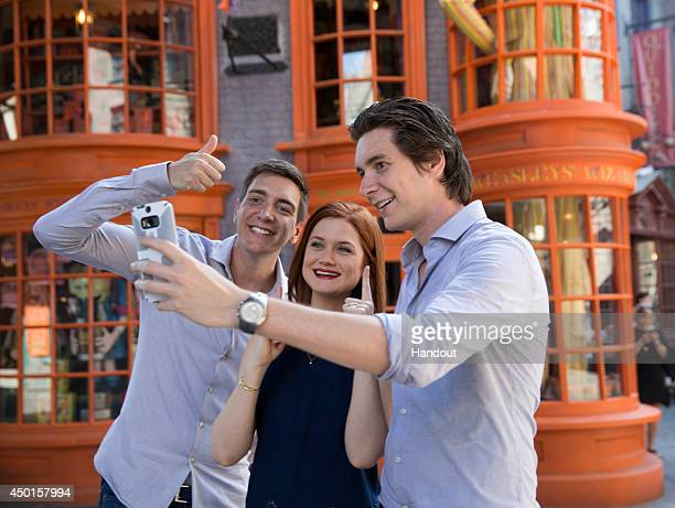 In this handout photo provided by Universal Orlando Resort James Phelps Bonnie Wright and Oliver Phelps from the popular Harry Potter film series...