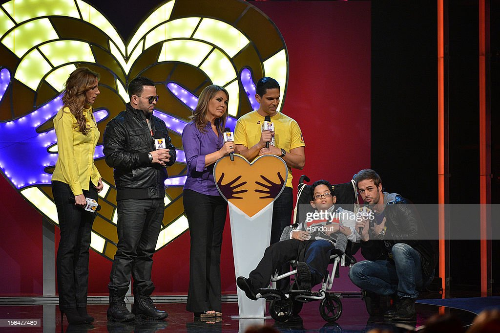 In this handout photo provided by Univision Networks, Latino star power united December 14, 2012 - December 16, 2012 in Miami, Florida at the 28- hour live- broadcast of TeletonUSA on Univision Network where more than $8,000,000 was raised, surpassing the $7,000,000 goal. Pictured L-R: 'El Gordo y La Flaca' co-host Lili Estefan, Puertorican singer Gocho, 'Noticiero Univision' news anchor Maria Elena Salinas, 'Sal y Pimienta' co-host Rodner Figueroa, one of the children who will benefit from TeletonUSA and international actor William Levy.