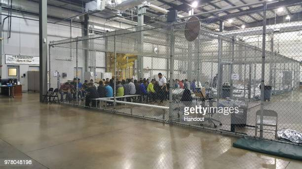 In this handout photo provided by U.S. Customs and Border Protection, U.S. Border Patrol agents conduct intake of illegal border crossers at the...