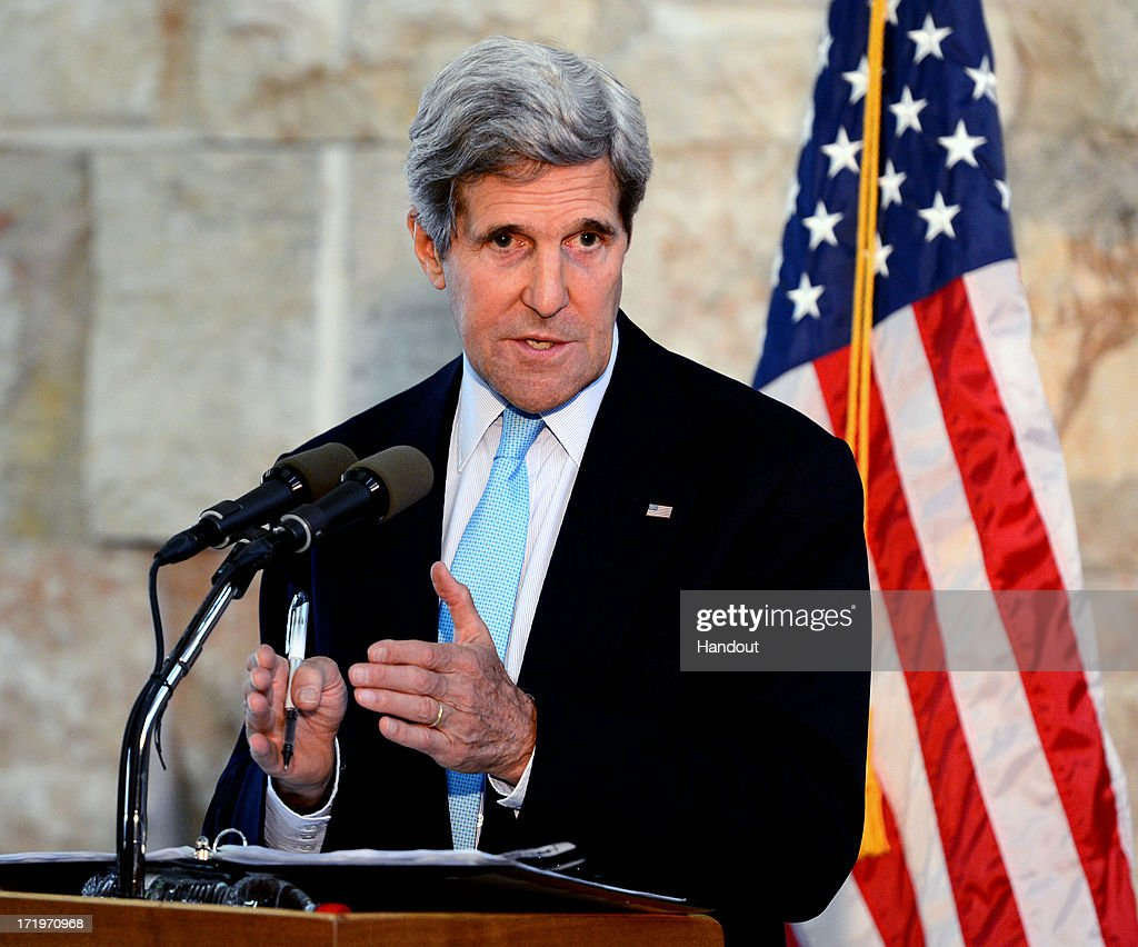 In this handout photo provided by U.S. Embassy Tel Aviv, U.S. Secretary of State John Kerry speaks during a press conference at Ben Gurion International Airport on June 30, 2013 in Tel Aviv, Israel. Kerry delivered an assessment after a final, frantic day of diplomacy that included a late-night meeting with Israeli Prime Minister Benjamin Netanyahu and a last-minute meeting in the West Bank with Palestinian President Mahmoud Abbas.