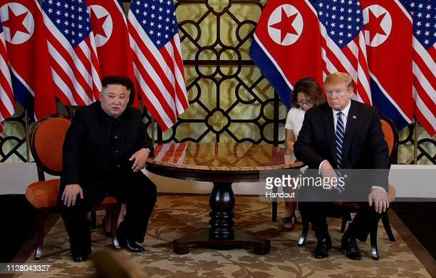 In this handout photo provided by Vietnam News Agency US President Donald Trump and North Korean leader Kim Jongun during their second summit meeting...