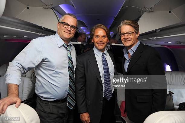 In this handout photo provided by Virgin America Airlines Virgin America president and CEO David Cush is joined by Portland Mayor Sam Adams and...