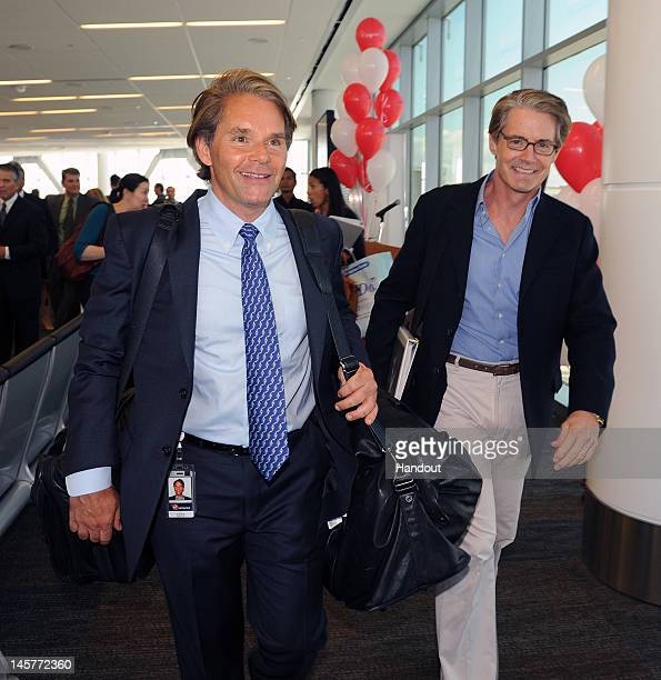 In this handout photo provided by Virgin America Airlines Virgin America president and CEO David Cush is joined by Portlandia star Kyle MacLachlan to...
