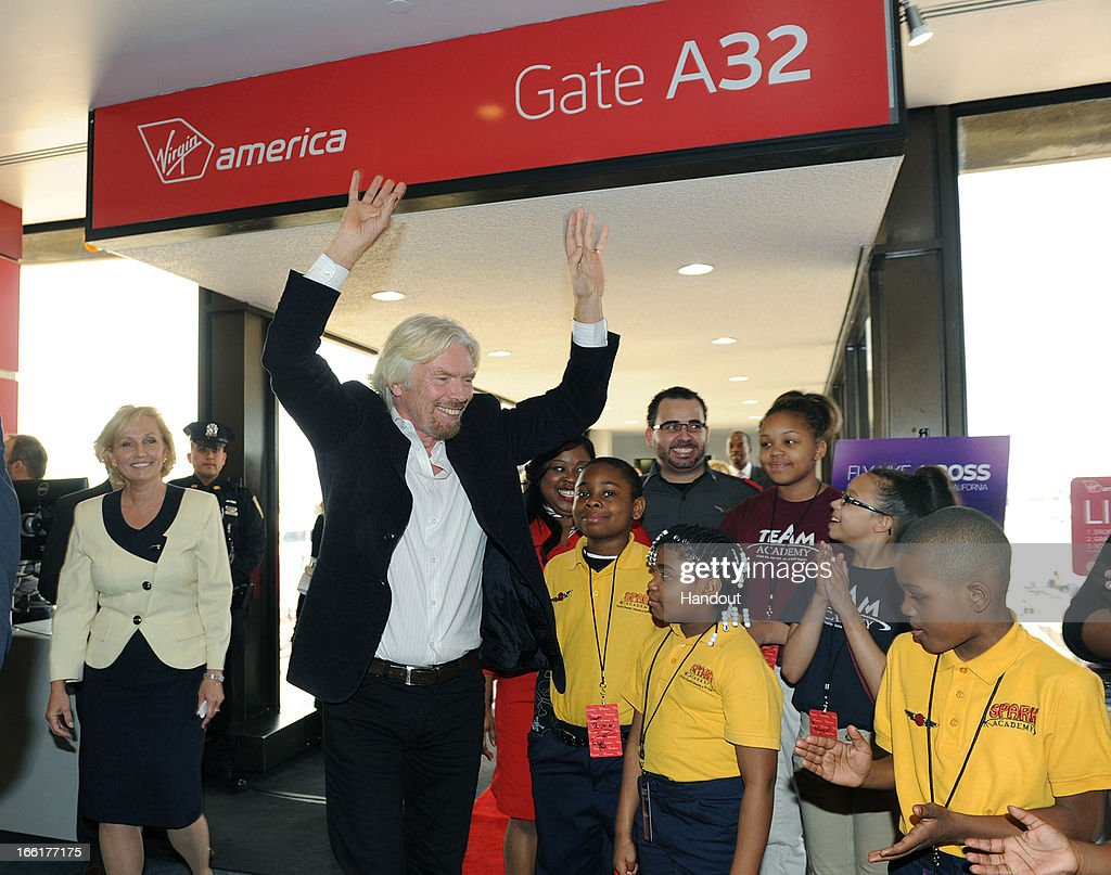 In this handout photo provided by Virgin America Airlines, Virgin Group Founder Sir Richard Branson is joined by New Jersey Lt. Governor Kim Guadagno (L) and young entrepreneurs with Jersey's 'Knowledge is Power Program' during celebration of launch of its new service to Newark, New Jersey from San Francisco and Los Angeles, at Newark Liberty International Airport (EWR), April 9, 2013 at Newark, New Jersey. Branson joined local flyers for a pre-flight Google+ 'Fly Like a Boss' hangout to discuss how technology is changing business and travel.