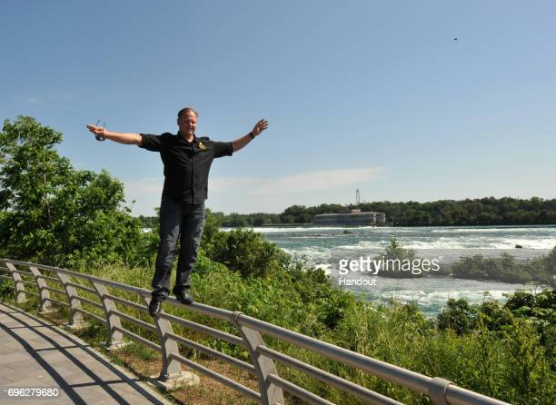 In this handout photo provided by Wallenda Incorporated, Nik Wallenda walks on the railing at Niagara Falls June 14, 2017 in Niagara Falls, New York....