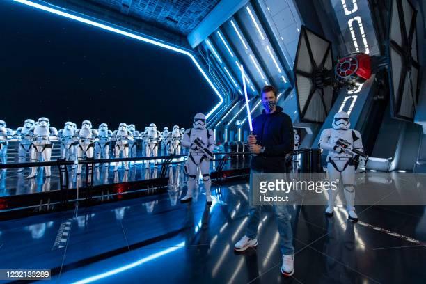 In this handout photo provided by Walt Disney Resorts, NFL superstar Tom Brady visits Star Wars: Galaxy's Edge inside Disney's Hollywood Studios at...