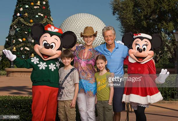 In this handout photo provided by Walt Disney World Catherine ZetaJones and Michael Douglas pose with their children Dylan age 10 and Carys age 7...
