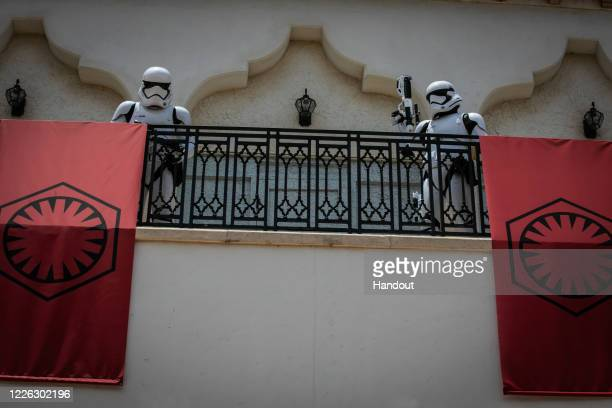 In this handout photo provided by Walt Disney World Resort, First Order Stormtroopers appear at Disney Springs at Walt Disney World Resort on May 27,...