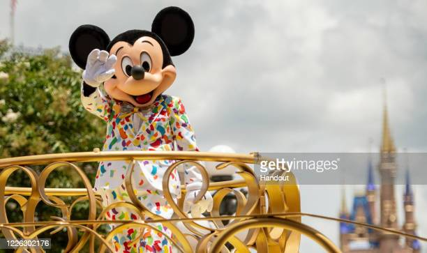 In this handout photo provided by Walt Disney World Resort Mickey Mouse stars in the Mickey and Friends Cavalcade on July 2 2020 in Lake Buena Vista...