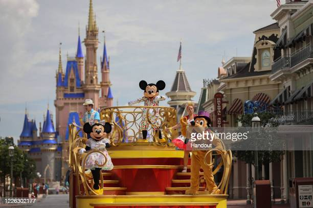 """In this handout photo provided by Walt Disney World Resort, Mickey Mouse stars in the """"Mickey and Friends Cavalcade on July 2, 2020 in Lake Buena..."""