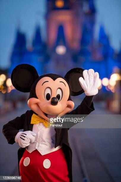 In this handout photo provided by Walt Disney World Resort, Mickey Mouse pauses on Main Street, U.S.A. Just before sunrise at Walt Disney World...