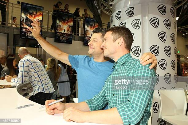 In this handout photo provided by Warner Bros Andy Serkis and Elijah Wood of 'The Hobbit The Battle of the Five Armies' attend ComicCon International...