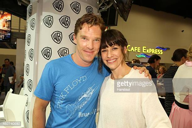 """In this handout photo provided by Warner Bros, Benedict Cumberbatch and Evangeline Lilly of """"The Hobbit: The Battle of the Five Armies"""" attend..."""