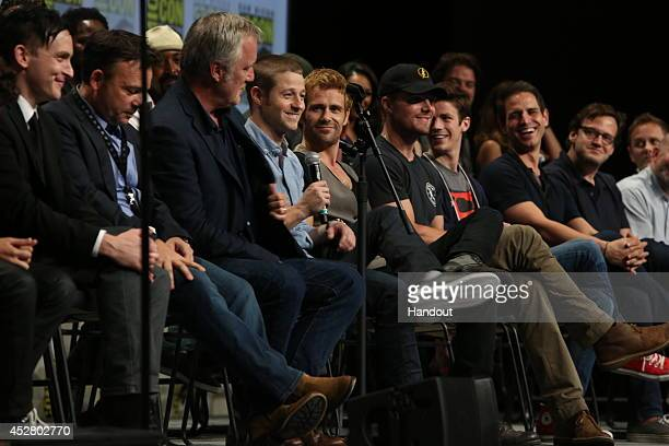 """In this handout photo provided by Warner Bros, cast and executive producers of """"Gotham,"""" """"Constantine."""" and """"Arrow"""" attends """"Warner Bros. Television..."""