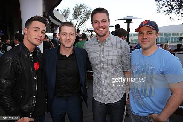 In this handout photo provided by Warner Bros Colton Haynes of 'Arrow' Ben McKenzie of 'Gotham' Stephen Amell of 'Arrow' and Geoff Johns Cheif...