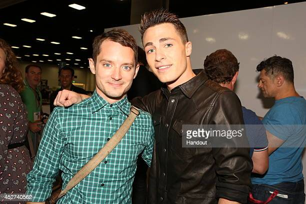 "In this handout photo provided by Warner Bros, Elijah Wood of ""The Hobbit: The Battle of the Five Armies"" and Colton Haynes of ""Arrow"" attend..."