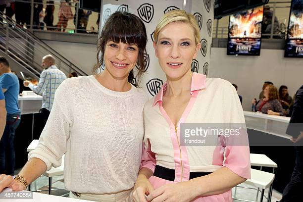 """In this handout photo provided by Warner Bros, Evangeline Lilly and Cate Blanchett of """"The Hobbit: The Battle of the Five Armies"""" attend Comic-Con..."""