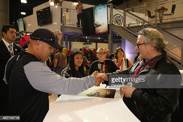 In this handout photo provided by Warner Bros George Miller of Mad Max Fury Road attend ComicCon International 2014 on July 26 2014 in San Diego...