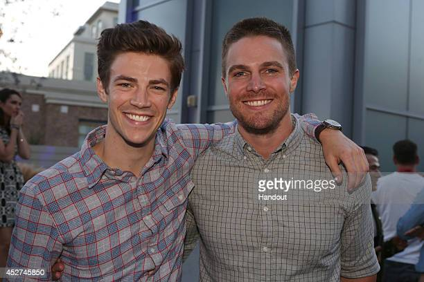 In this handout photo provided by Warner Bros Grant Gustin of The Flash and Stephen Amell of Arrow attend Warner Bros Television's ComicCon cocktail...