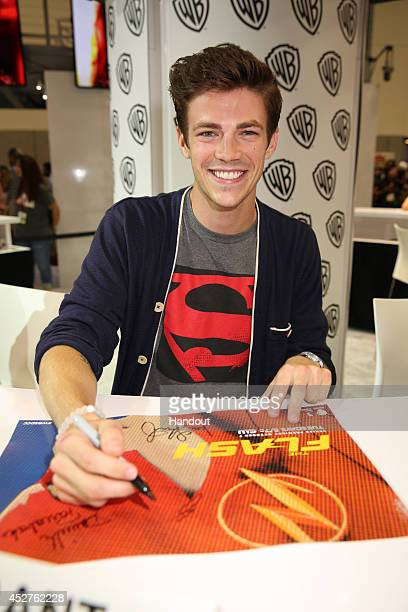 In this handout photo provided by Warner Bros Grant Gustin of The Flash attends ComicCon International 2014 on July 26 2014 in San Diego California
