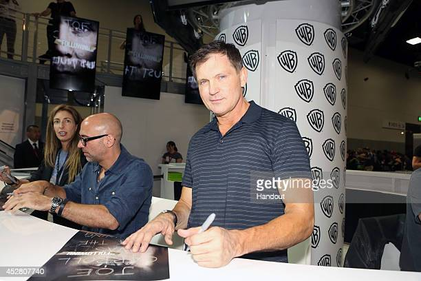 In this handout photo provided by Warner Bros Kevin Williamson with executive producers Marcos Siega to his left and Jennifer Johnson of 'The...