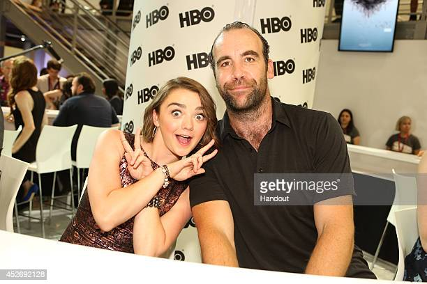In this handout photo provided by Warner Bros Maisie Williams and Rory McCann of 'Game of Thrones' attend ComicCon International 2014 on July 25 2014...