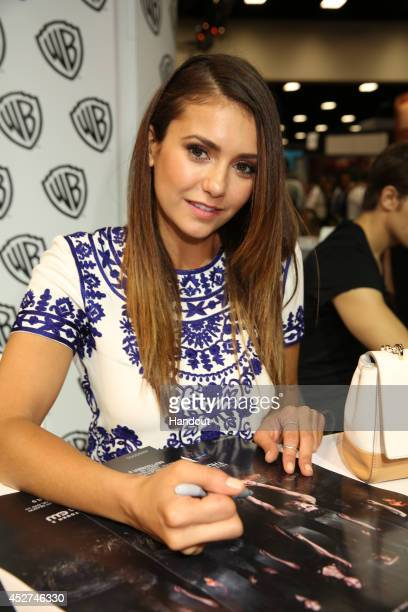 """In this handout photo provided by Warner Bros, Nina Dobrev of """"The Vampire Diaries"""" attends Comic-Con International 2014 on July 26, 2014 in San..."""