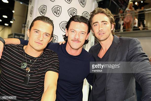 In this handout photo provided by Warner Bros Orlando Bloom Luke Evans and Lee Pace of 'The Hobbit The Battle of the Five Armies' attend ComicCon...