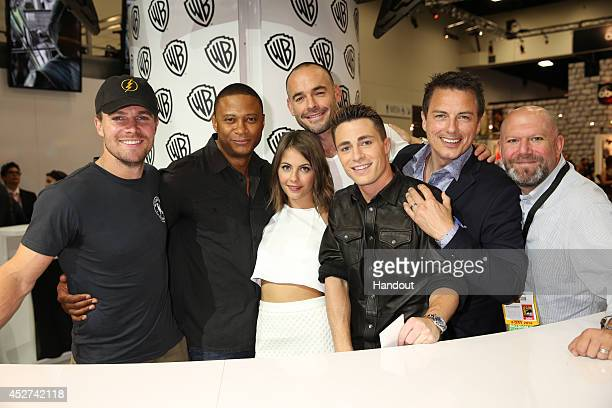 In this handout photo provided by Warner Bros Stephen Amell David Ramsey Willa Holland Paul Blackthorne Colton Haynes and John Barrowman with...