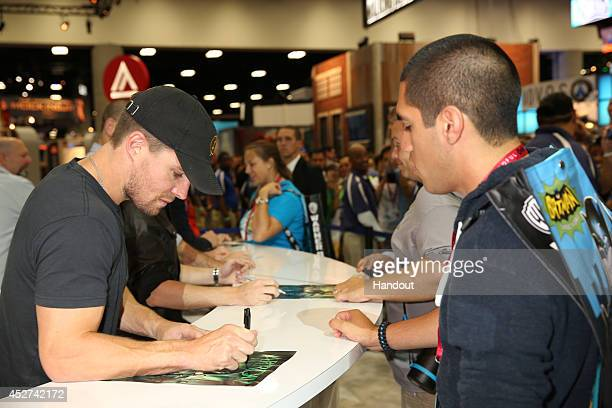 In this handout photo provided by Warner Bros Stephen Amell of Arrow attends ComicCon International 2014 on July 26 2014 in San Diego California