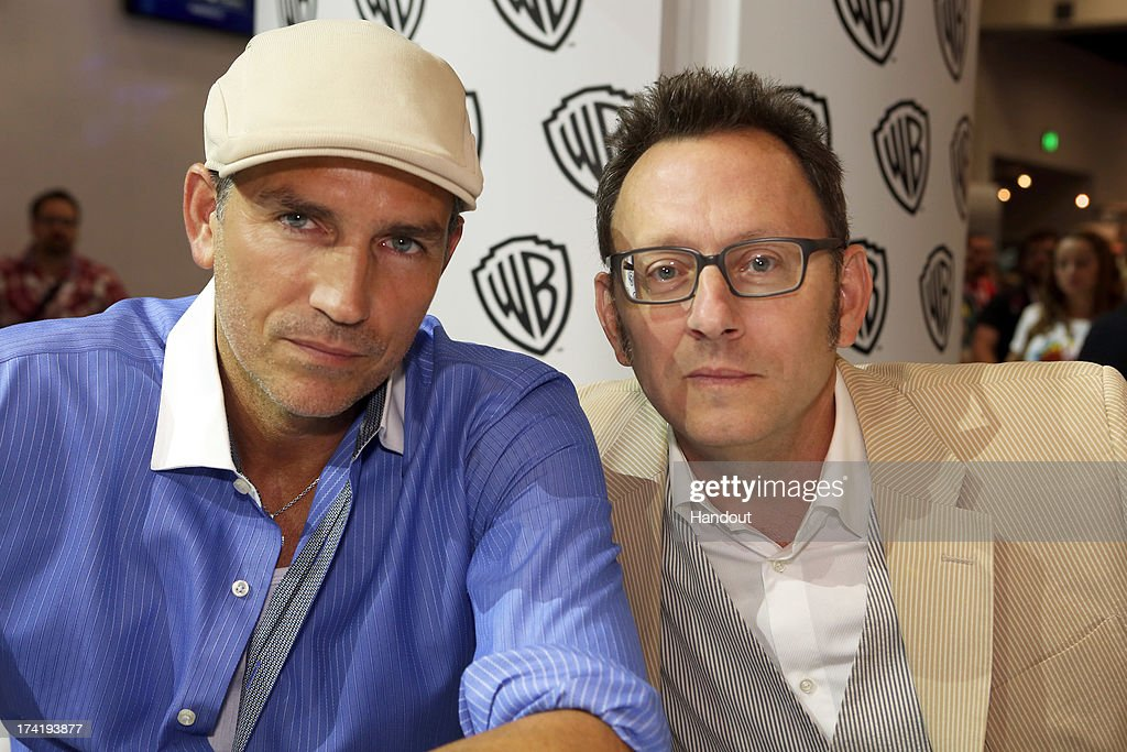 In this handout photo provided by WBTV, Actors Jim Caviezel and Michael Emerson meet fans during the 'Person of Interest' signing at the Warner Bros. booth during Comic-Con on July 20, 2013 in San Diego, California.