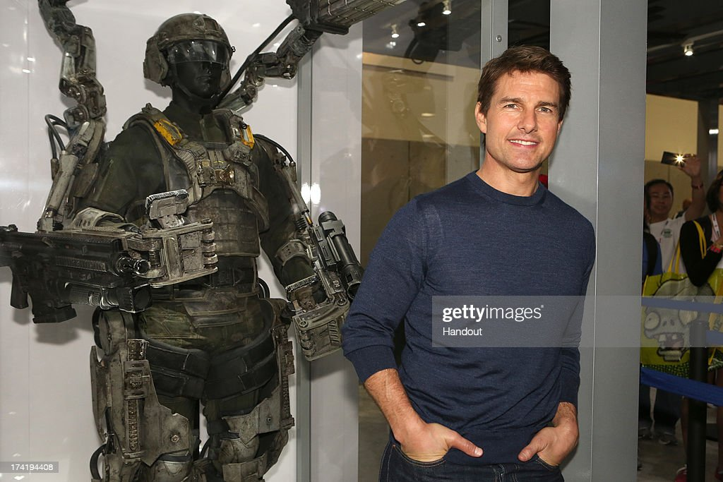 In this handout photo provided by WBTV, 'Edge of Tomorrow' star Tom Cruise with his futuristic battle gear at the Warner Bros. booth during Comic-Con 2013 on July 20, 2013 in San Diego, California.