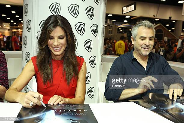 In this handout photo provided by WBTV GRAVITY star Sandra Bullock and writer/producer/director Alfonso Cuaron attend the GRAVITY signing at the...