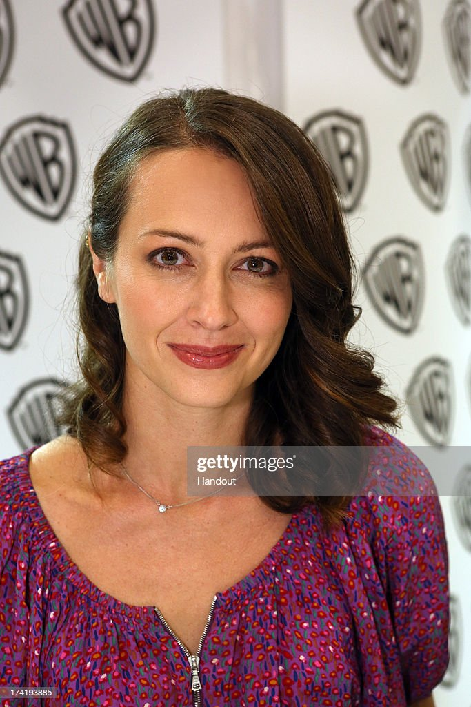 In this handout photo provided by WBTV, 'Person of Interest' star Amy Acker attends the Warner Bros. booth during Comic-Con on July 20, 2013 in San Diego, California.