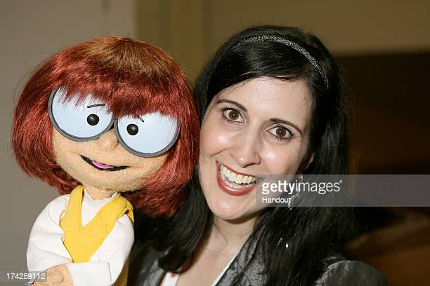 In this handout photo provided by WBTV 'ScoobyDoo Adventures The Mystery Map'voice star Stephanie D'Abruzzo with Velma at the Warner Bros booth...
