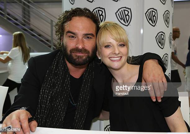 In this handout photo provided by WBTV series stars Johnny Galecki and Melissa Rauch pose for a photo at THE BIG BANG THEORY signing in the Warner...