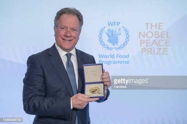 In this handout photo provided by WFP, David Beasley, Executive Director of the United Nations World Food Programme poses with the Nobel Peace Prize...