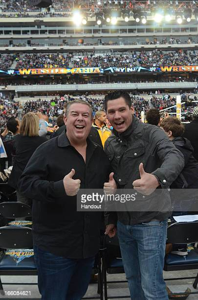 In this handout photo provided by WWE Inc Elvis Duran and Alex Carr from WW 29 visit MetLife Stadium April 7 2013 in East Rutherford New Jersey