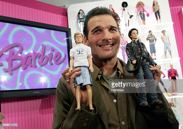 In this handout photo released by Mattel celebrity stylist Phillip Bloch unveils the new Ken dolls February 9 2006 in New York City The doll at left...