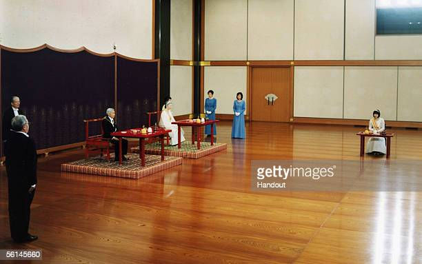 In this Handout Photo released by the Imperial Household Agency, Japan's Princess Sayako , Emperor Akihito and Empress Michiko attend a traditional...