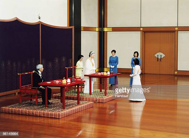 In this Handout Photo released by the Imperial Household Agency Japan's Princess Sayako exchanges farewell greetings with Emperor Akihito as Empress...