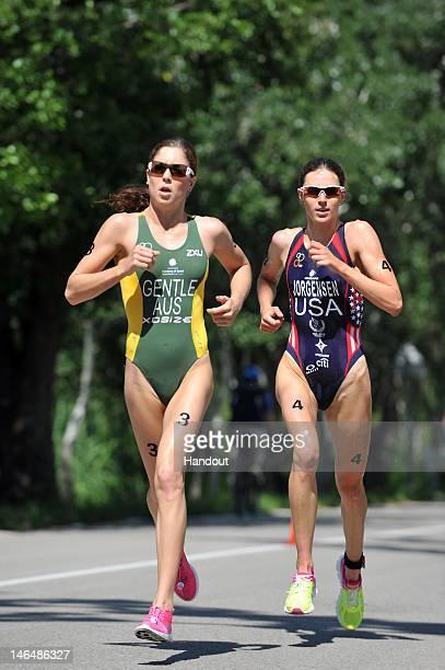 In this handout photo released by the International Triathlon Union, Australia's Ashleigh Gentle and USA's Gwen Jorgensen battle head to head during...