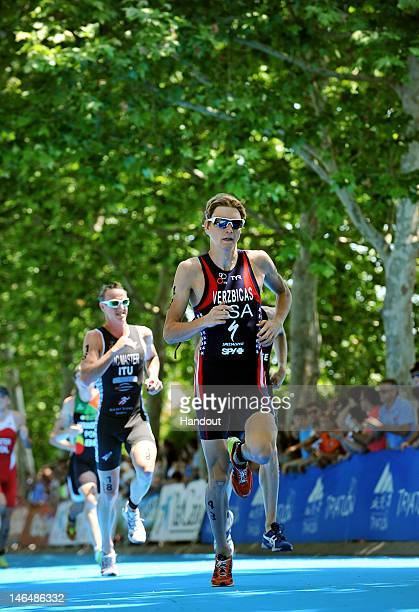 In this handout photo released by the International Triathlon Union, USA's Lukas Verzbicas begins to make his move on the run and storms to his first...