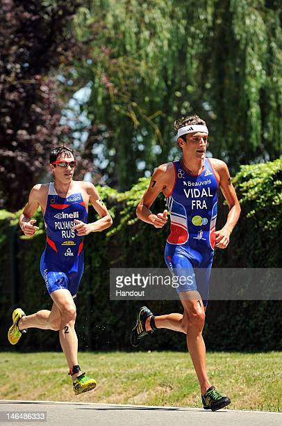 In this handout photo released by the International Triathlon Union, France's Laurent Vidal and Russia's Dmitry Polyanskiy lead the run at the 2012...