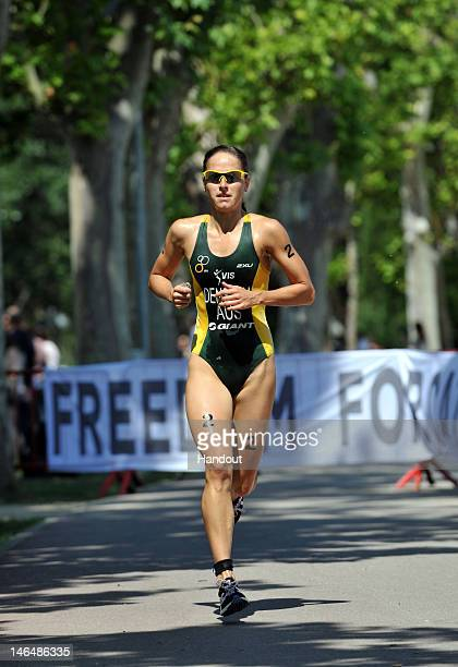 In this handout photo released by the International Triathlon Union, Australia's Erin Densham holds the pace on the run leg of the 2012 Banyoles ITU...