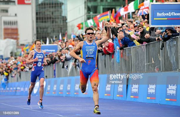 In this handout photo released by the International Triathlon Union Javier Gomez of Spain wins in front of Jonathan Brownlee of Great Britain the...